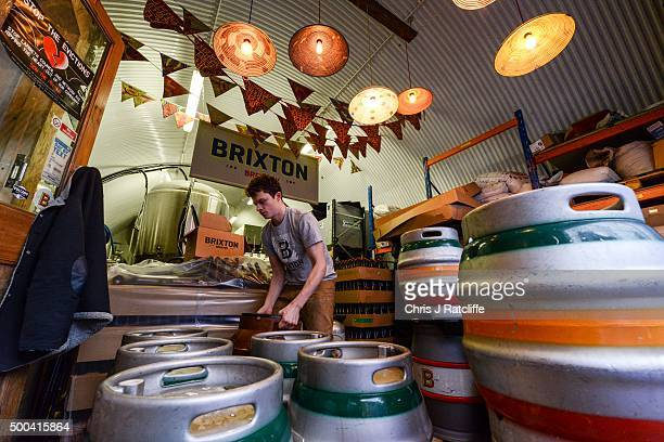A brewer labels casks full of Effra Ale at inner city craft beer makers Brixton Brewery on December 8 2015 in London England Located in three railway...