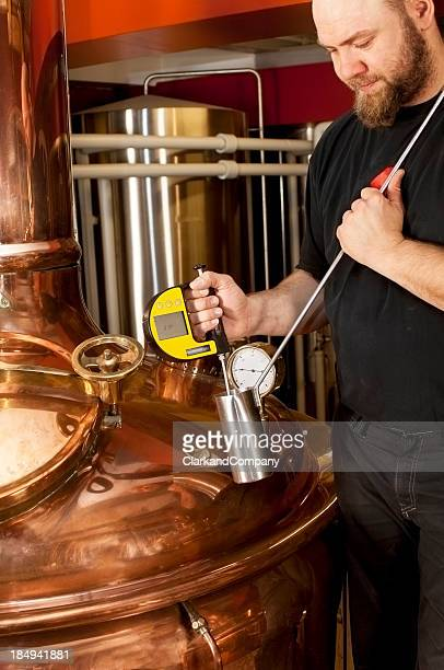 Brewer Testing His Brew at a Microbrewery