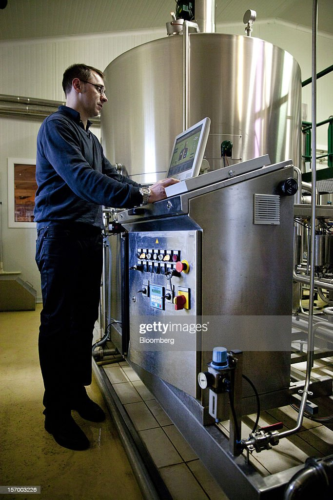 A brewer use a computer to regulate the fermentation process at the Brasserie Saint Germain brewery during the beer manufacturing process in Aix-Noulette, in France, on Monday, Nov. 26, 2012. Producers of beer in France, for instance, say any development plans they had have been 'nipped in the bud' by Hollande's plan to boost the tax on the drink next year. Photographer: Balint Porneczi/Bloomberg via Getty Images