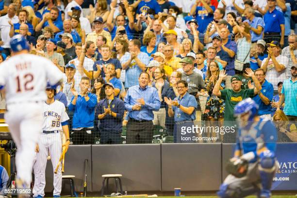 Brewers owner Mark Attanasio cheers on Milwaukee Brewers Catcher Stephen Vogt as he trots into home plate during the second game of the final home...