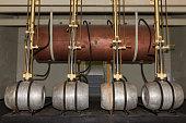 Copper brevery vessel with beer kegs
