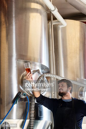 Brewmaster Checking His Beer
