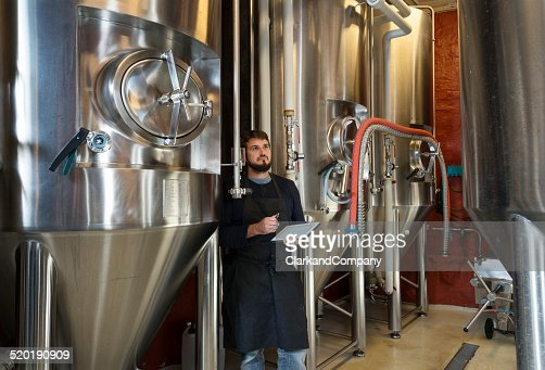 Brewmaster Checking His Brew