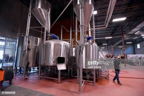 Brewmaster Josh Robbins of New Terrain Brewing brews a Colorado IPA on July 19 2017 at New Terrain Brewing in Golden Josh says his 'Colorado IPA is a...