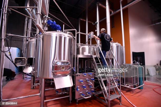 Brewmaster Josh Robbins of New Terrain Brewing check the vats where he brews a Colorado IPA on July 19 2017 at New Terrain Brewing in Golden Josh...