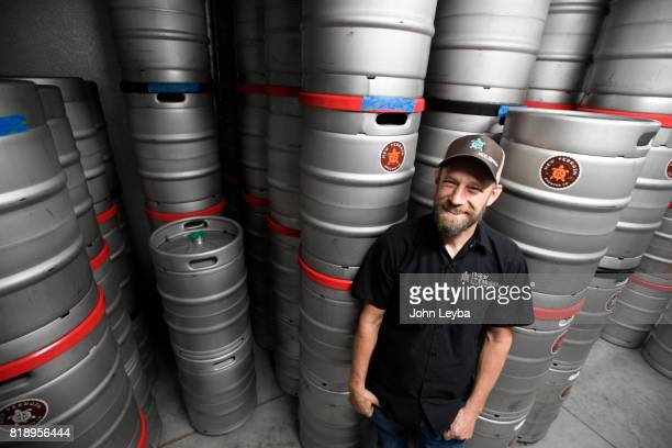 Brewmaster Josh Robbins of New Terrain Brewing in the cooler with kegs of beer on July 19 2017 at New Terrain Brewing in Golden Josh says his...