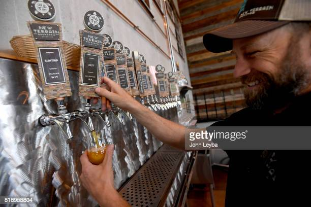 Brewmaster Josh Robbins of New Terrain Brewing pours a Colorado IPA on July 19 2017 at New Terrain Brewing in Golden Josh says his Colorado IPA...