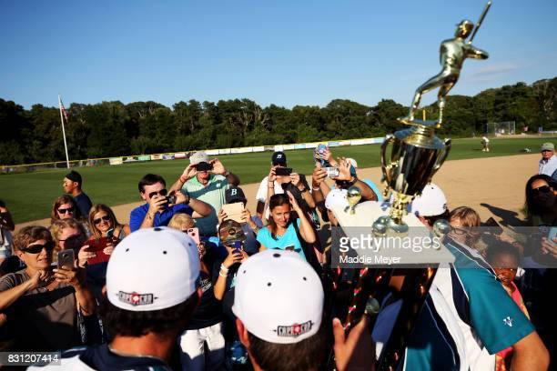 Brewster Whitecaps fans take pictures of the team with the trophy after they defeated the Bourne Braves 20 to win the Cape Cod League Championship...