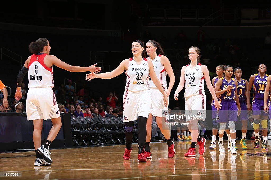 Bria Hartley and Jelena Milovanovic of the Washington Mystics slap hands during the game against the Los Angeles Sparks at the Verizon Center on June...