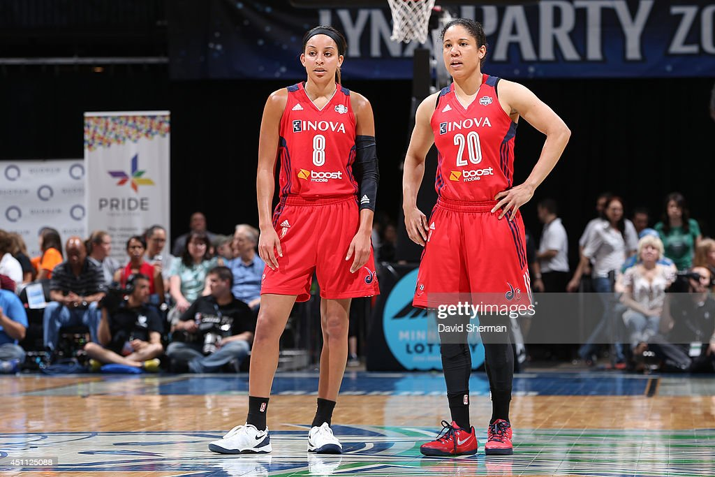 Bria Hartley and Kara Lawson of the Washington Mystics during the game against the Minnesota Lynx on June 20 2014 at Target Center in Minneapolis...