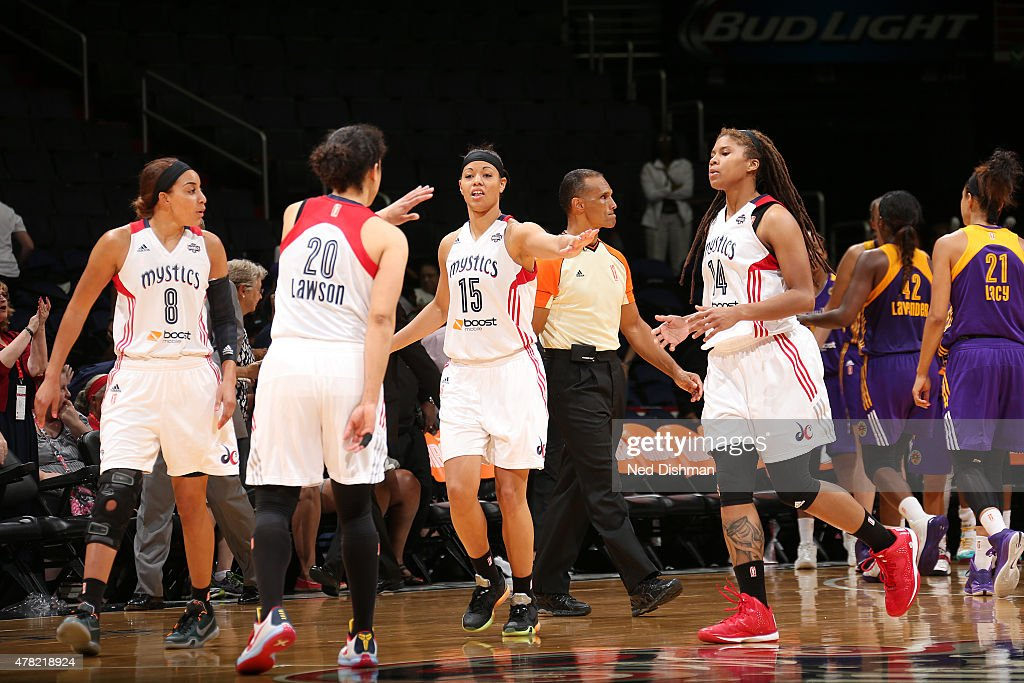 Bria Hartley Kara Lawson Natasha Cloud and Tierra RuffinPratt of the Washington Mystics celebrate in a WNBA game against the Los Angeles Sparks at...
