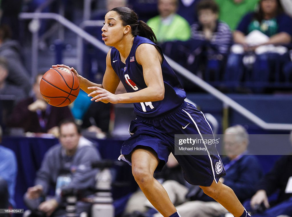 Bria Hartley #14 of the Connecticut Huskies dribbles the ball against the Notre Dame Fighting Irish at Purcel Pavilion on March 4, 2013 in South Bend, Indiana. Notre Dame defeated Connecticut 96-87 in triple overtime to win the Big East regular season title.