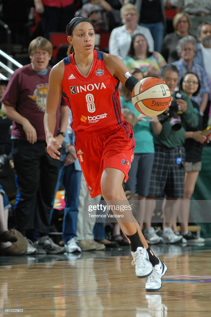 <a gi-track='captionPersonalityLinkClicked' href=/galleries/search?phrase=Bria+Hartley&family=editorial&specificpeople=7334401 ng-click='$event.stopPropagation()'>Bria Hartley</a> #8 of the Washington Mystics dribbles the ball during the game against the Seattle Storm on June 22,2014 at Key Arena in Seattle, Washington.