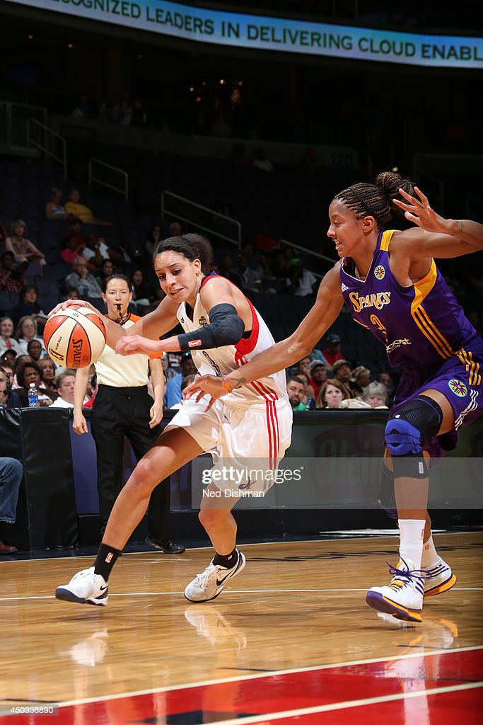Bria Hartley of the Washington Mystics drives against Candace Parker of the Los Angeles Sparks at the Verizon Center on June 1 2014 in Washington DC...