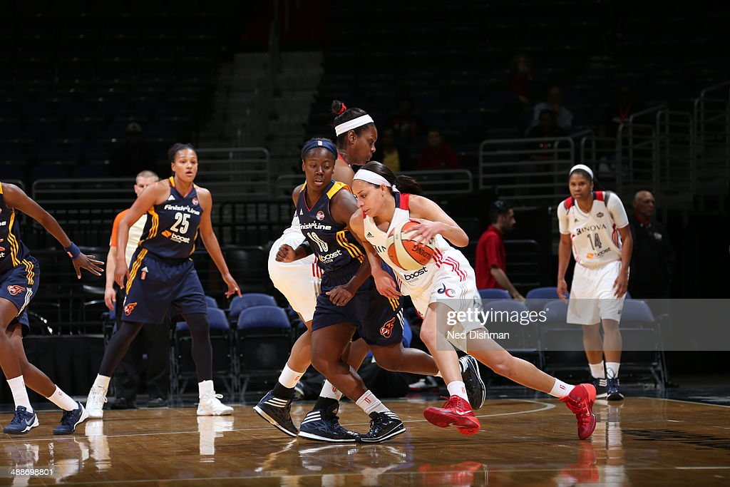 Bria Hartley of the Washington Mystics drives against Jaterra Bonds of the Indiana Fever at the Verizon Center on May 7 2014 in Washington DC NOTE TO...
