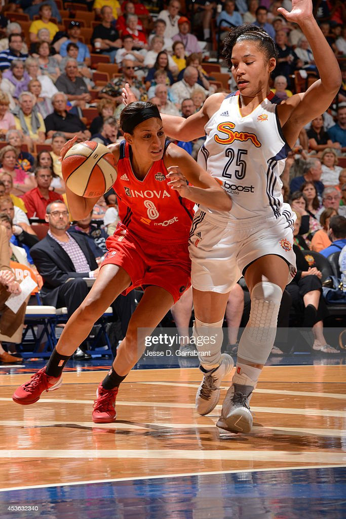 <a gi-track='captionPersonalityLinkClicked' href=/galleries/search?phrase=Bria+Hartley&family=editorial&specificpeople=7334401 ng-click='$event.stopPropagation()'>Bria Hartley</a> #8 of the Washington Mystics drives to the basket against <a gi-track='captionPersonalityLinkClicked' href=/galleries/search?phrase=Alyssa+Thomas&family=editorial&specificpeople=7287086 ng-click='$event.stopPropagation()'>Alyssa Thomas</a> #25 of the Connecticut Sun during the game on August 10, 2014 at the Mohegan Sun in Uncasville, Connecticut.