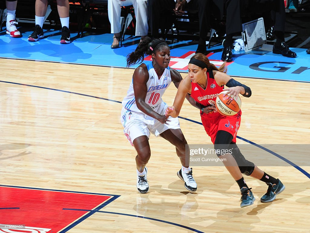 Bria Hartley of the Washington Mystics drives to the basket against Matee Ajavon of the Atlanta Dream at the Philips Center on June 26 2015 in...