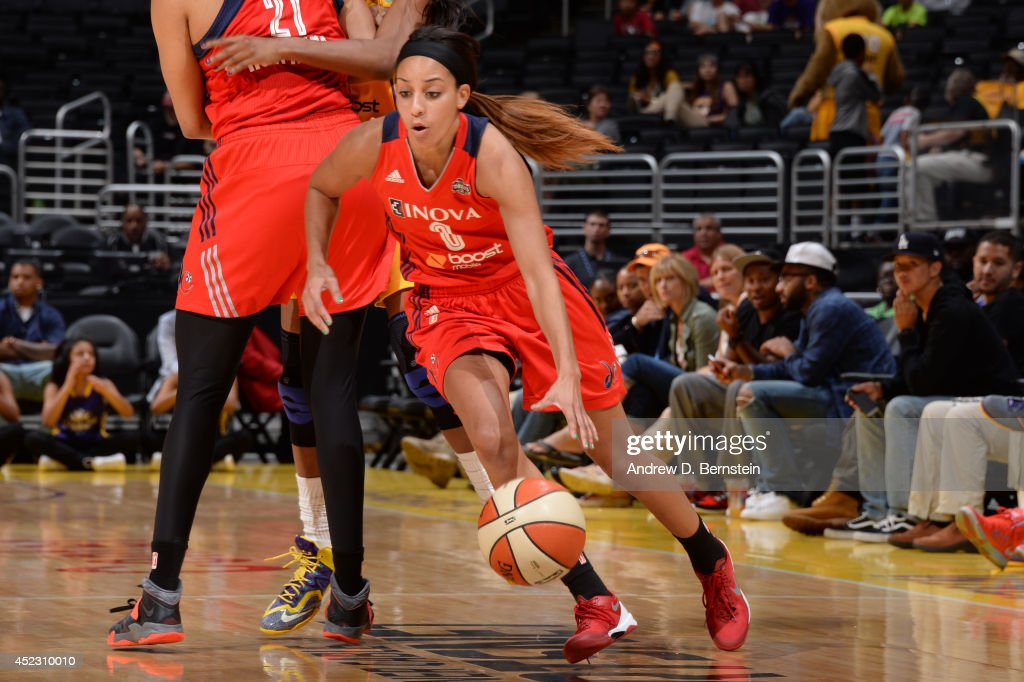 Bria Hartley of the Washington Mystics drives to the basket during a game against the Los Angeles Sparks at STAPLES Center on July 17 2014 in Los...