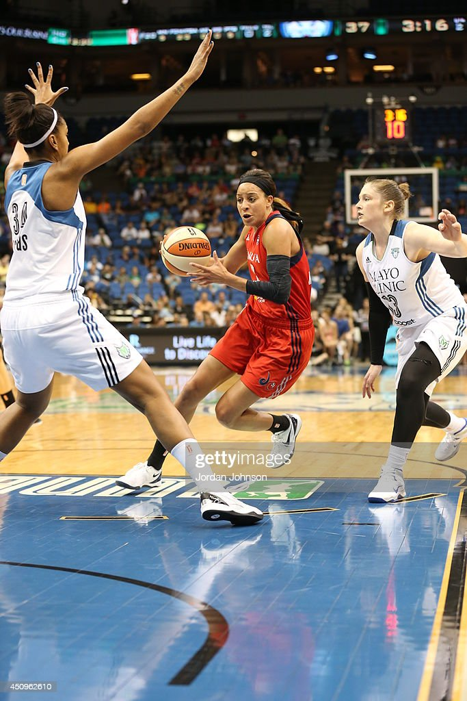 Bria Hartley of the Washington Mystics goes to the basket against Damiris Dantas of the Minnesota Lynx during the WNBA game on June 20 2014 at Target...