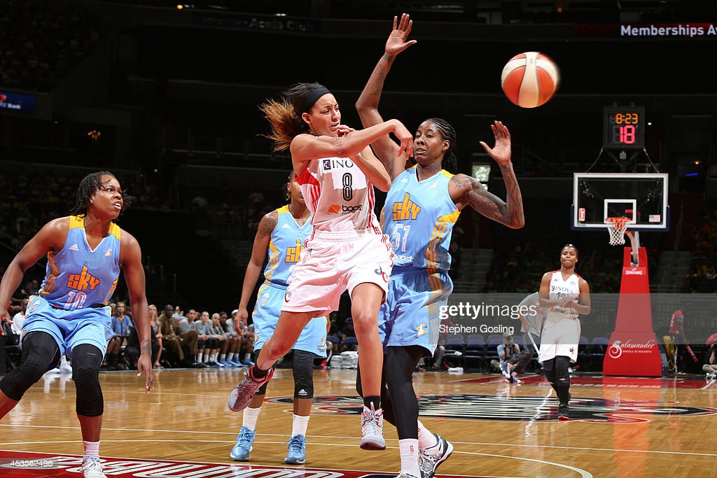 Bria Hartley #8 of the Washington Mystics passes against Jessica Breland #51 of the Chicago Sky at the Verizon Center on August 13, 2014 in Washington, DC.