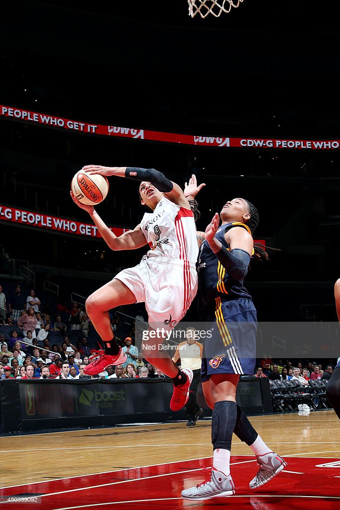 Bria Hartley #8 of the Washington Mystics shoots against Erlana Larkins #2 of the Indiana Fever at the Verizon Center on June 6, 2014 in Washington, DC.