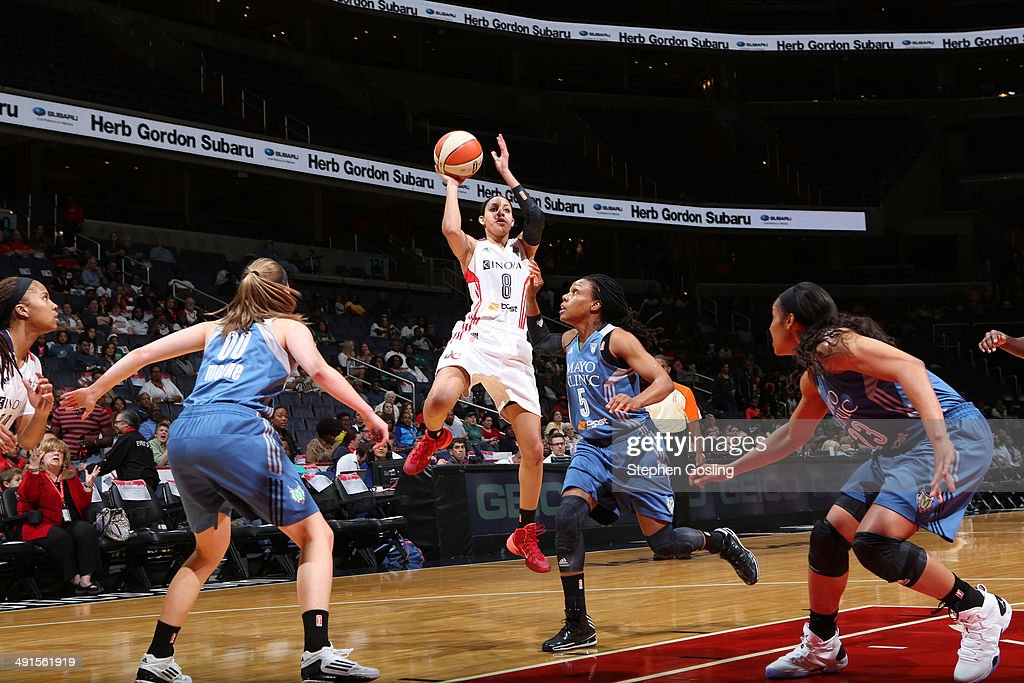 <a gi-track='captionPersonalityLinkClicked' href=/galleries/search?phrase=Bria+Hartley&family=editorial&specificpeople=7334401 ng-click='$event.stopPropagation()'>Bria Hartley</a> #8 of the Washington Mystics shoots against Tan White #5 of the Minnesota Lynx at the Verizon Center on May 16, 2014 in Washington D.C.