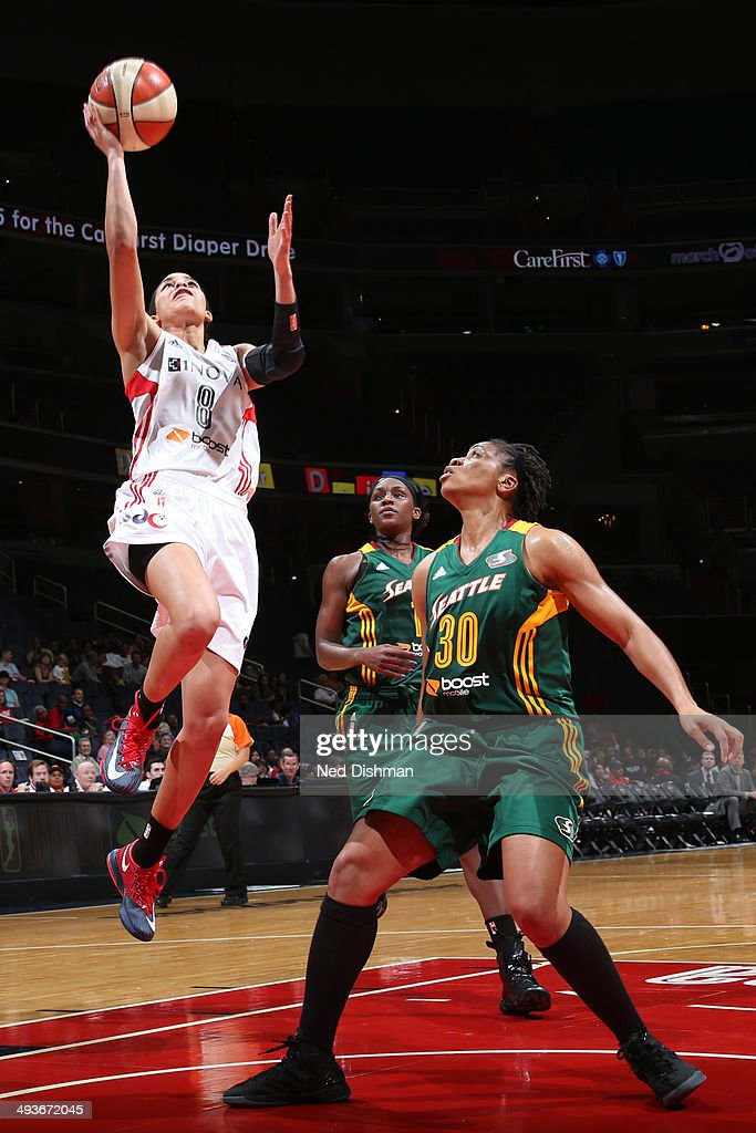 Bria Hartley of the Washington Mystics shoots against the Seattle Storm at the Verizon Center on May 24 2014 in Washington DC NOTE TO USER User...
