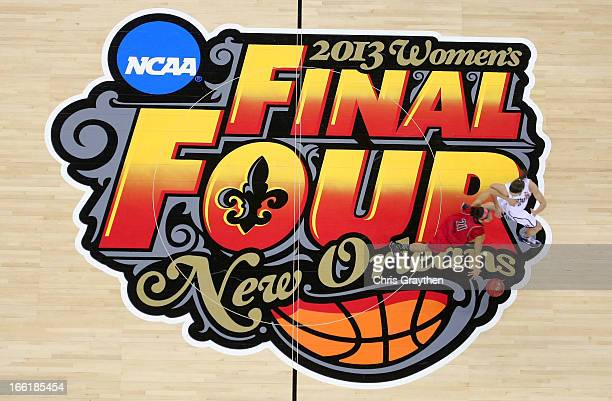 Bria Smith of the Louisville Cardinals dribbles across the center court logo against the Connecticut Huskies during the 2013 NCAA Women's Final Four...