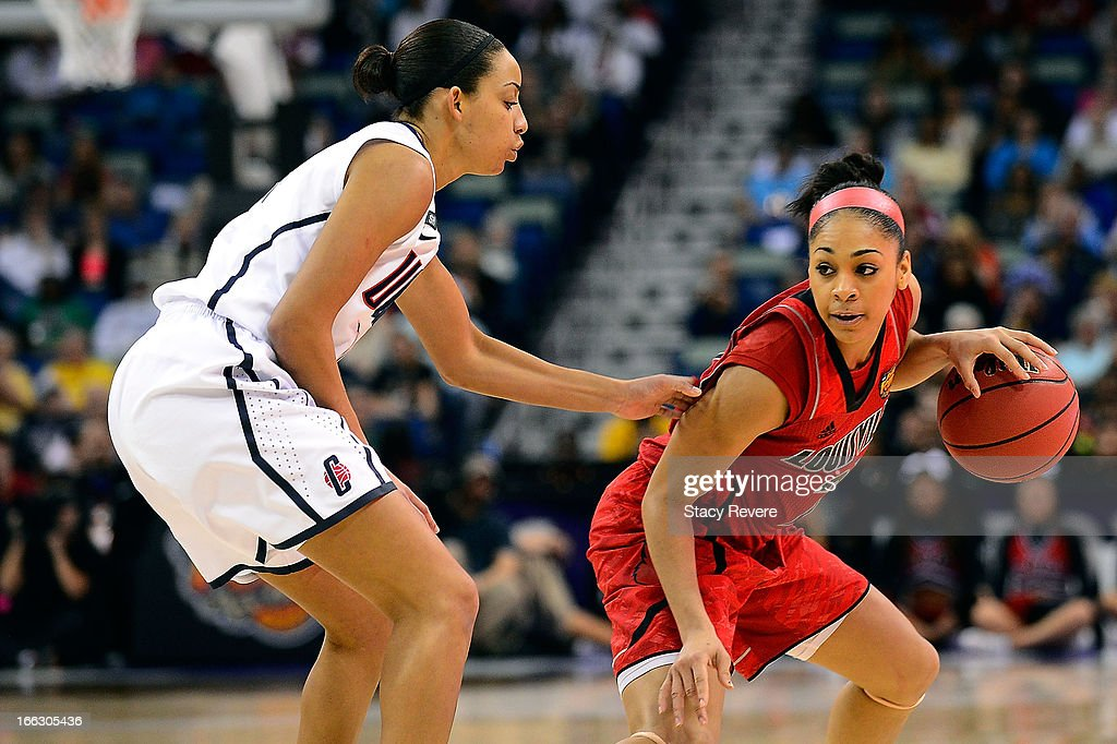 Bria Smith #21 of the Louisville Cardinals is defended by Bria Hartley #14 of the Connecticut Huskies during the National Final game of the 2013 NCAA Division I Women's Basketball Championship at New Orleans Arena on April 9, 2013 in New Orleans, Louisiana.