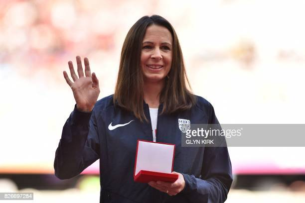 Briain's Jo Pavey poses with her bronze medal during the medal reallocation victory ceremony for the women's 10000m athletics event from the 2007...