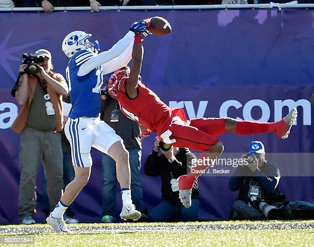 Brian Allen of the Utah Utes breaks up a catch by Mitch Mathews of the Brigham Young Cougars during the Royal Purple Las Vegas Bowl at Sam Boyd...