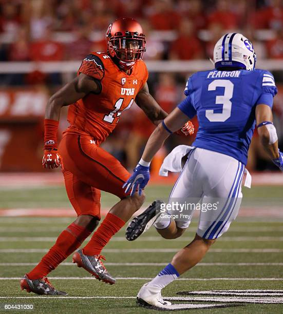 Brian Allen of the Utah Utes defends Colby Pearson of the Brigham Young Cougars during the second half at Rice Eccles Stadium on September 10 2016 in...