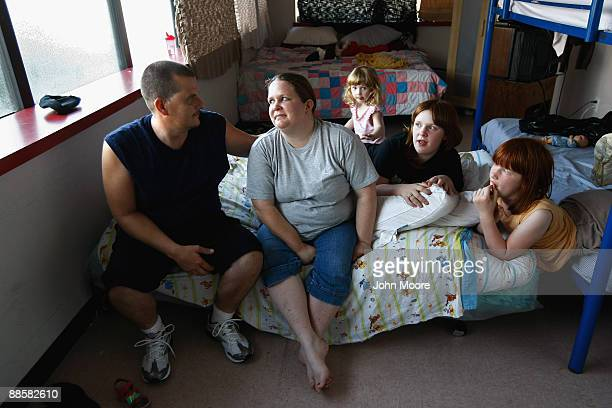 Brian and Julie Morris sit with their three daughters in their room at the Family Gateway homeless shelter on June 18 2009 in Dallas Texas Julie...