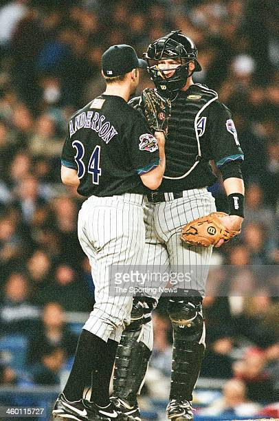 Brian Anderson and Damian Miller of the Arizona Diamondbacks talk during Game Three of the World Series against the New York Yankees on October 30...