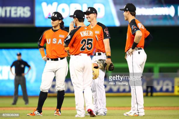Brian Anderson Bo Bichette Scott Kingery and Ryan McMahon of Team USA look on during a pitching change during the SirusXM AllStar Futures Game at...