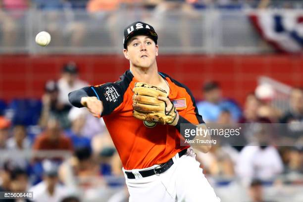 Brian Anderson of Team USA throws to first base for the out during the SirusXM AllStar Futures Game at Marlins Park on Sunday July 9 2017 in Miami...