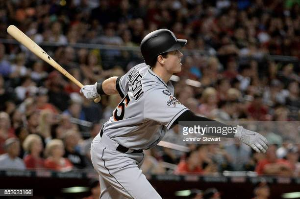 Brian Anderson of the Miami Marlins hits a sacrifice fly ball driving in a run against the Arizona Diamondbacks in the third inning at Chase Field on...