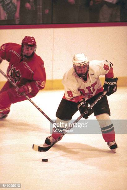 Brian Armes of Rochester Institute of Technology avoids Rob Retter of Plattsburg State University during the 2001 NCAA Men's Ice Hockey Championship...