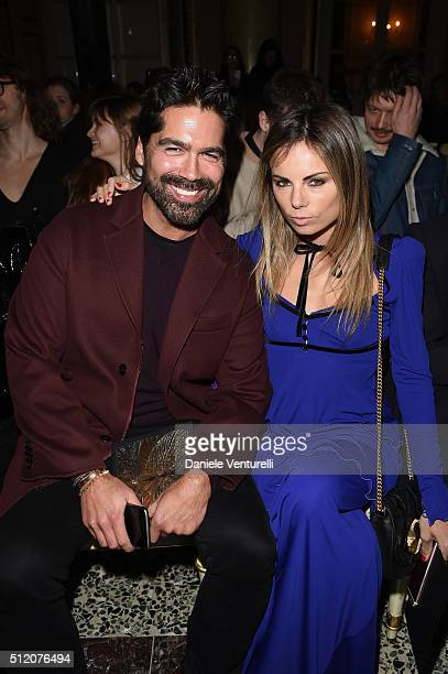 Brian Atwood and Erica Pelosini attend the Roberto Cavalli show during Milan Fashion Week Fall/Winter 2016/17 on February 24 2016 in Milan Italy