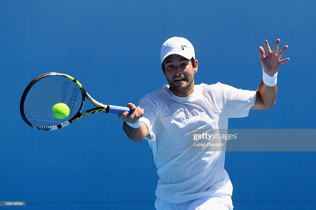 Brian Baker of the United States of America plays a forehand in his first round match against Alex Bogomolov Jr. of Russia during day one of the 2013 Australian Open at Melbourne Park on January 14, 2013 in Melbourne, Australia.