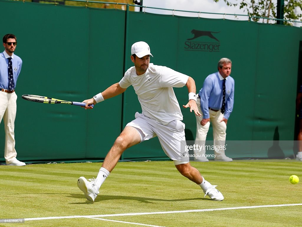Brian Baker of USA in action against Marin Cilic of Croatia in the mens' singles on day one of the 2016 Wimbledon Championships at the All England Lawn Tennis and Croquet Club in London, United Kingdom on June 27, 2016.
