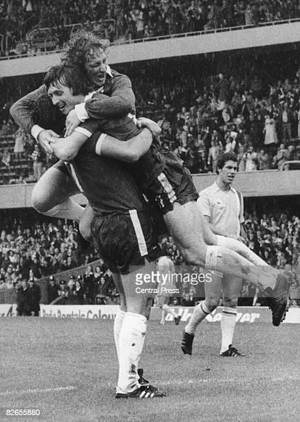 Brian Bason of Chelsea is congratulated by teammates Kenny Swain and Ray Lewington after scoring Chelsea's first goal during a match against Cardiff...