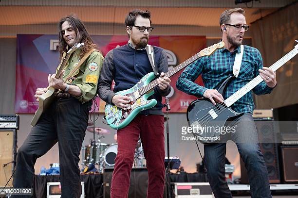 Brian Bell Patrick Wilson Rivers Cuomo and Scott Shriner of Weezer perform during Taste of Chicago 2015 at Petrillo Music Shell on July 8 2015 in...