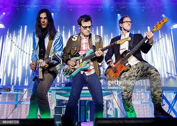 Brian Bell Rivers Cuomo and Scott Shriner of the american rock band Weezer perform onstage at Deer Lake Park Festival Lawn on July 28 2016 in Burnaby...