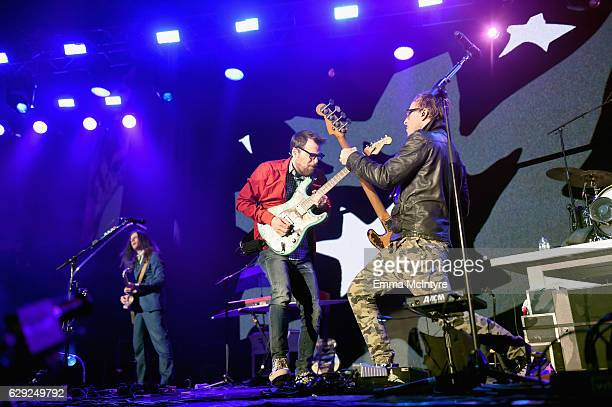 Brian Bell Rivers Cuomo and Scott Shriner of the band Weezer perform onstage at 1067 KROQ Almost Acoustic Christmas 2016 Night 2 at The Forum on...