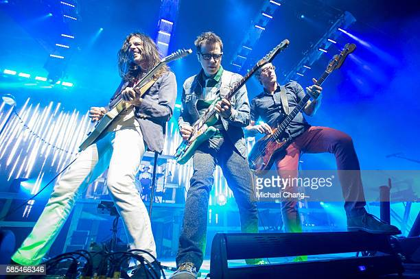 Brian Bell Rivers Cuomo and Scott Shriner of Weezer perform at AkChin Pavilion on August 2 2016 in Phoenix Arizona