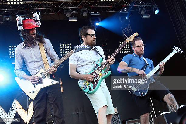Brian Bell Rivers Cuomo and Scott Shriner of Weezer perform during Project Pabst 2015 at Zidell Yards on July 19 2015 in Portland Oregon