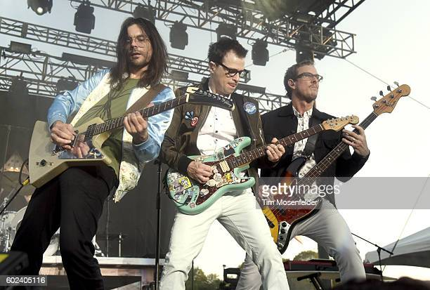 Brian Bell Rivers Cuomo and Scott Shriner of Weezer perform during City of Trees festival at Bonney Field on September 10 2016 in Sacramento...