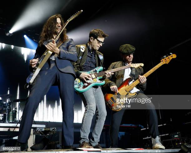 Brian Bell Rivers Cuomo and Scott Shriner of Weezer perform during the 2017 Boston Calling Music Festival at Harvard Athletic Complex on May 28 2017...