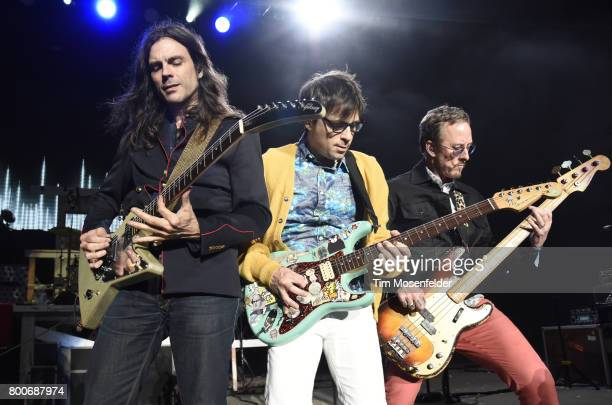 Brian Bell Rivers Cuomo and Scott Shriner of Weezer perform during the ID10T Festival at Shoreline Amphitheatre on June 24 2017 in Mountain View...